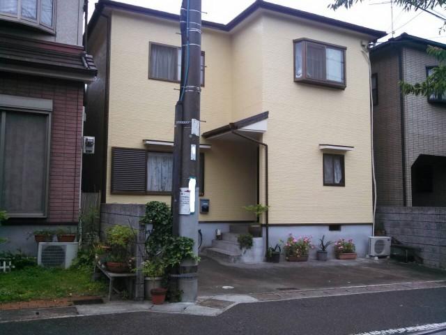 クリーム色の外観になった塗装後の兵庫県明石市H様邸